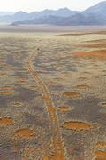 Land Rover on deserted track in the Namib Desert, Namibia, Africa Stock Photos
