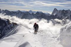 Mountaineers and climbers, Aiguille du Midi, Mont Blanc Massif, Chamonix, French Stock Photos