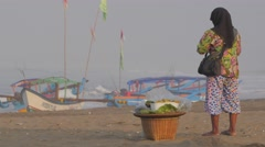 Muslim food seller on beach,Pangandaran,Java,Indonesia Stock Footage