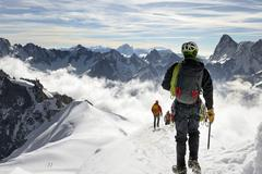 Mountaineers and climbers, Aiguille du Midi, Mont Blanc Massif, Chamonix, French - stock photo