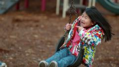Girl spinning on swing in slow motion; shot on Phantom Flex 4K at 500 fps Stock Footage