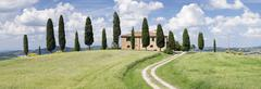 Farm house with cypress trees near Pienza, Val d'Orcia (Orcia Valley), UNESCO - stock photo