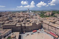 Old town with Santa Maria Assunta Cathedral and Piazza del Campo, Siena, UNESCO - stock photo