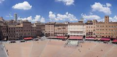 Piazza del Campo with Santa Maria Assunta Cathedral on skyline, Siena, UNESCO - stock photo