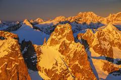 Aerial view of peaks Torrone and Bernina Group at sunset, Masino Valley, - stock photo