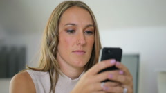 Businesswoman using mobile phone in office Stock Footage