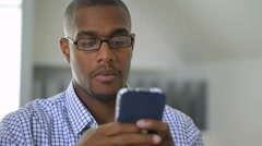 Businessman using mobile phone in office Stock Footage