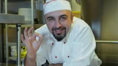 Chef shows OK gesture after having cooked delicious pizza Stock Footage
