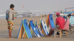 Men renting surf boards on the beach,Pangandaran,Java,Indonesia Stock Footage