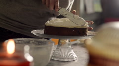 Woman Icing a Fruitcake Stock Footage