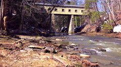 A beautiful covered bridge over a river in Ohio. - stock footage
