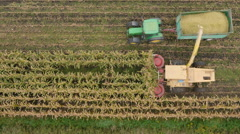 4K Aerial: Above Combine Corn Machines Stock Footage
