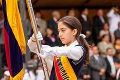 Stock Photo of Young School Girl Holding With Pride The National Flag Of Ecuador For The Summer