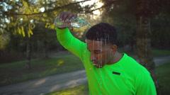 Slow motion shot of runner cooling off, shot on Phantom Flex 4K Stock Footage