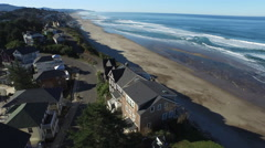 Aerial view of homes along Oregon coast line - stock footage