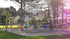 Family playing volleyball at park Stock Footage