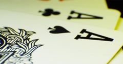 Various playing card background. Loop rotation on the table. Macro shot 4K Stock Footage