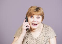 Very emotional golden teeth woman with the telephone handset Stock Photos