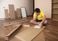 Assembling furniture - stock photo