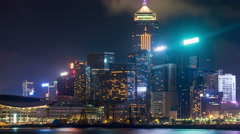 Hong Kong Island skyline at night with cloudy sky. Timelapse. Stock Footage