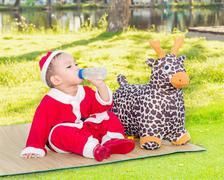 Snap shot photography,  Asian baby boy in santa claus suit Stock Photos