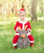 Asian baby  in santa claus suit - stock photo