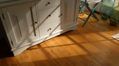 Interior of beach home with sunlight hitting floor Stock Footage