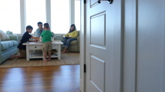 Family playing games together at beach house Stock Footage