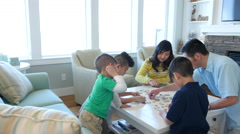 Family playing games together at beach house - stock footage