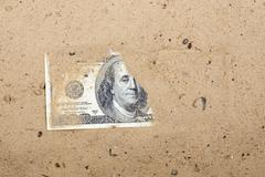Dollars in the sand Stock Photos
