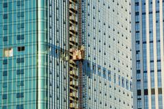 New office building under construction on blue sky. Building construction of hug Stock Photos