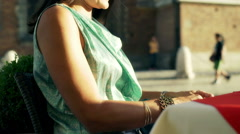 Happy woman sitting in the cafe and looking on pearls, steadycam shot Stock Footage