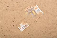 Euro in the sand Stock Photos