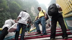 Tourists and Malaysian climbing up the stairs at Batu Caves. Stock Footage