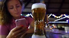 Woman Typing Text Message on Smart Phone in Bar Stock Footage