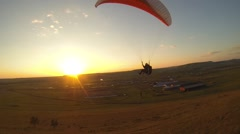 Paragliding on sunrise - stock footage