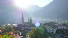 Timelapse – Morning Sun in Mountain Village - stock footage