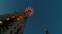 Wide of Eclipse at dusk Gröna Lund amusement park in central Stockholm Stock Footage