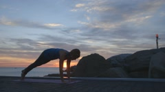 Yoga sequence at sunrise Stock Footage
