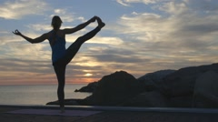 Backlit Yoga by the water Stock Footage