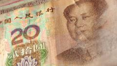 Stock Video Footage of Chinese Yuan / Renminbi Pan Right to Show Mao