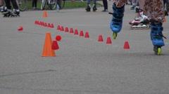 Roller skaters foot ride on one wheel slalom. 4K Stock Footage