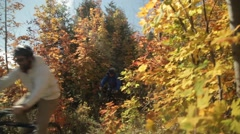 Mountain biking in the fall - stock footage
