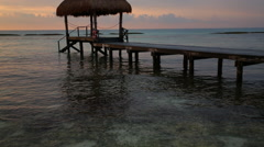 Woman walking on pier at tropical resort Stock Footage