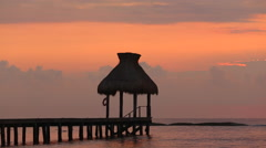 Dock during sunset at tropical resort Stock Footage