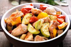 Fried vegetables with chicken meat Stock Photos