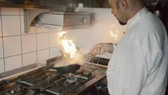 Slow motion clip of chef cooking meat in frying pan Stock Footage