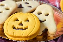 Pumpkin-shaped and ghost-shaped cookies Stock Photos