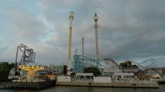 Wide shot of Gröna Lund amusement park in central Stockholm Stock Footage
