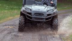 Closeup of atv going through mud in slow motion Stock Footage